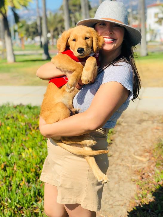 Elizabeth with one of her favorite pals, charlie, on east beach in santa barbara, CA.