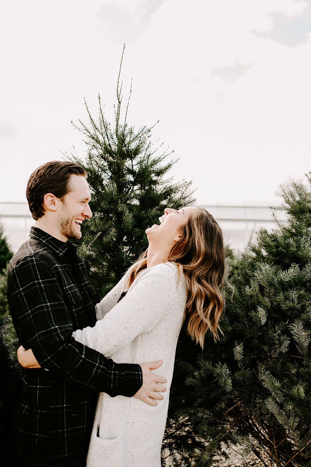 Urban Noblesville, Indiana Engagement Session with Alex and Andy by Emily Elyse Wehner Photography | Posing inspiration | Couples session outfit inspiration | Urban engagement
