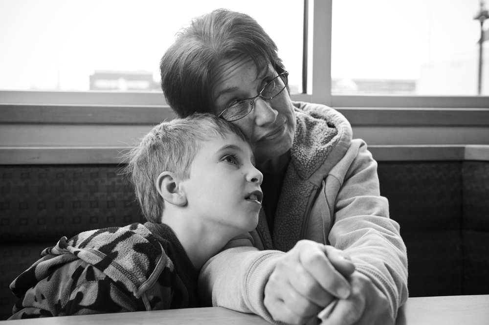Jones and her adopted step grandson Brian, 6, rest on each other at a Dairy Queen after a long day of school in Bowling Green, Ky.