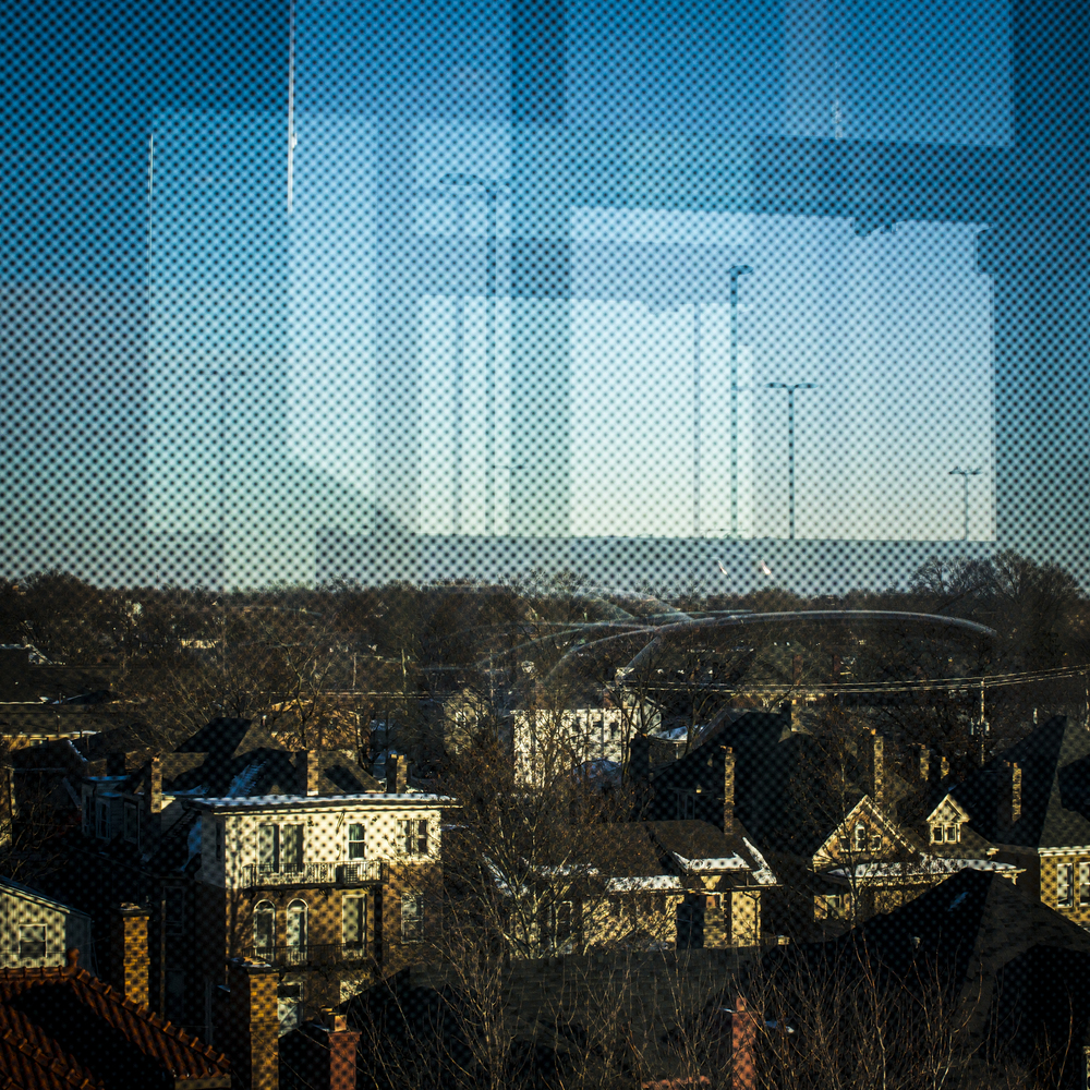 Houses along Neal Avenue are seen through the reflective window in the elevator of the Ninth Avenue East Garage in Columbus, Ohio on Wednesday, Dec. 18, 2013. The Ohio State University campus is quiet, cold and desolate after finals ended last week on December 11th and will start back for the Spring 2014 semester on January 6th.