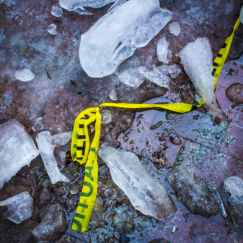 Fallen ice is sectioned off by caution tape as ice melts outside the Key Bank Building along East Lynn Street in Columbus, Ohio on Saturday, Dec. 28, 2013. Downtown Columbus is relatively empty as many residences are at home enjoying time with their family and friends.