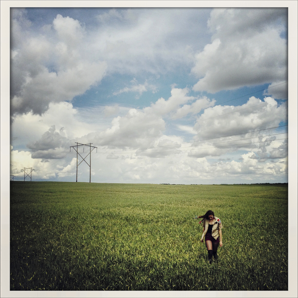 Nikki walking through a field in Larned, Kansas.