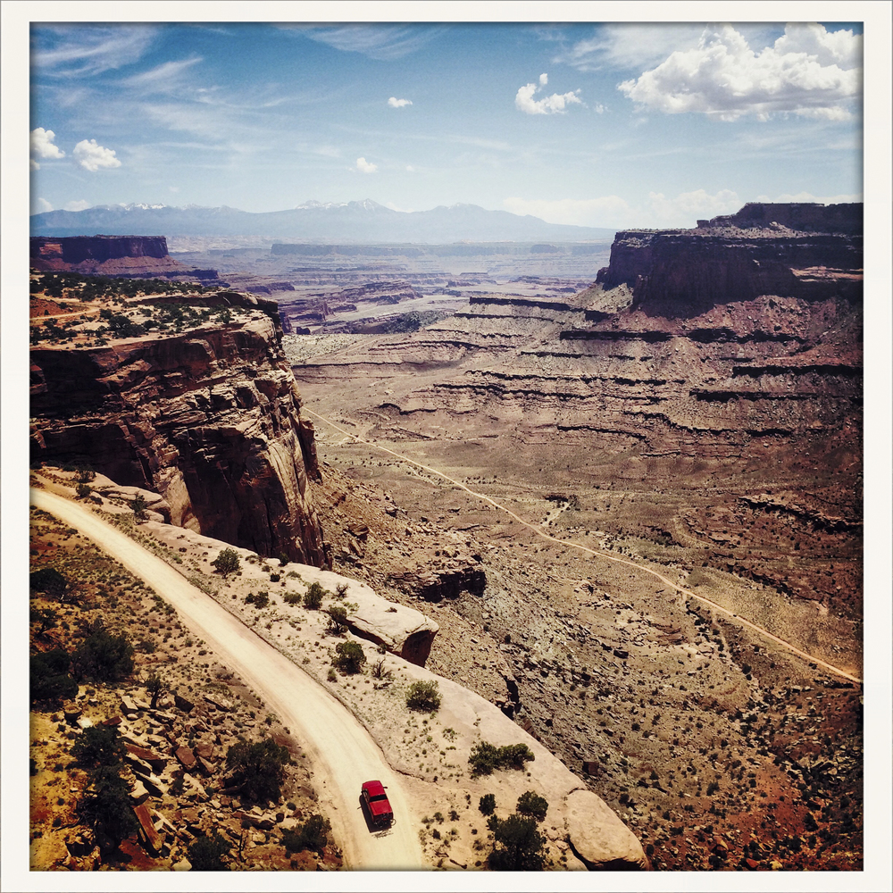 A red truck on the Island in The Sky side of Canyonlands National Park in Utah.