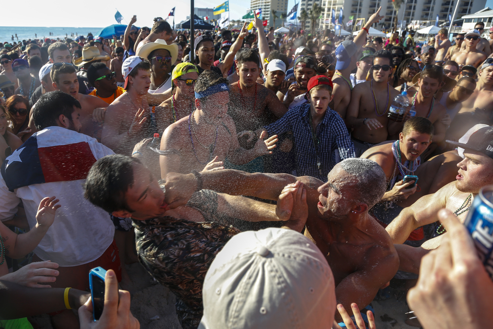 Spring breakers fight on the beach in Panama City Beach, Fla. on Thursday March 14, 2012.
