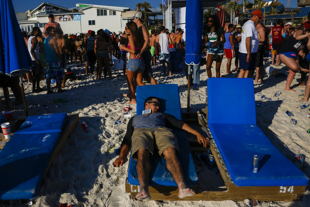 A spring breaker lays passed out in Panama City Beach, Florida.