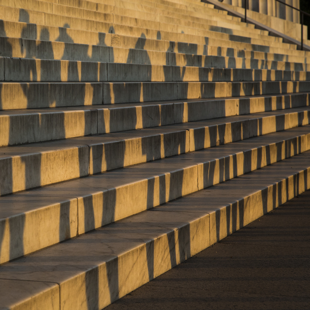 The shadows of a group of runners can be seen as they line up to start a work out at the Lincoln Memorial on the morning of Wednesday June 4, 2014. The Lincoln Memorial is an American national monument built to honor the 16th President of the United States, Abraham Lincoln. The building contains a large seated sculpture of Abraham Lincoln and inscriptions of two well-known speeches by Lincoln, The Gettysburg Address and his Second Inaugural Address.
