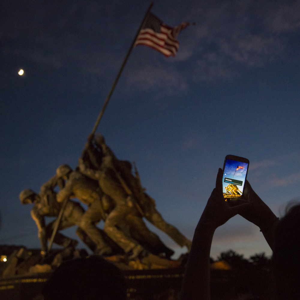 Visitors and groups of children stop to make photos of the National Iwo Jima Memorial. The US National Iwo Jima Memorial is located on Ella Grasso Boulevard, near the New Britain/Newington town line in Connecticut. It was erected by the Iwo Jima Survivors Association, Inc. of Newington, Connecticut. It was dedicated on February 23, 1995 on the 50th anniversary of the historic flag raising on Iwo Jima. It is dedicated to the memory of the 6,821 US servicemen who gave their lives at Iwo Jima. Inscribed on the base are the names of the 100 men from Connecticut who gave their lives in the battle.