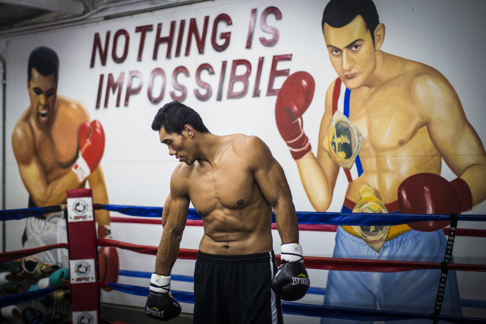 Taishan Dong a 6-foot-11 and 285 pounds Chinese boxer works out and spars with coach John Bray at the Glendale Fighting Club in Glendale on Wednesday July 30, 2014. Dong requires a custom-made mouthguard, cup and gloves to accommodate his massive size.