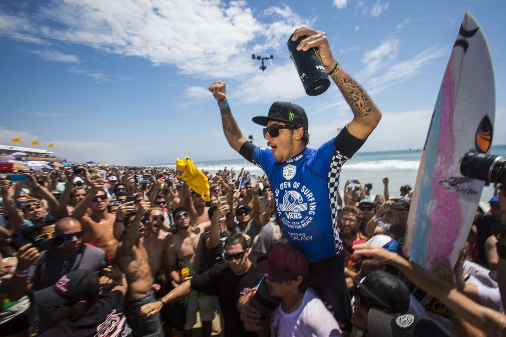 Filipe Toledo celebrates with friend, family and fans after winning during the final round of the men's surfing main event during the last day of the Vans US Open at the Huntington Beach Pier in Huntington Beach on Sunday August 03, 2014.