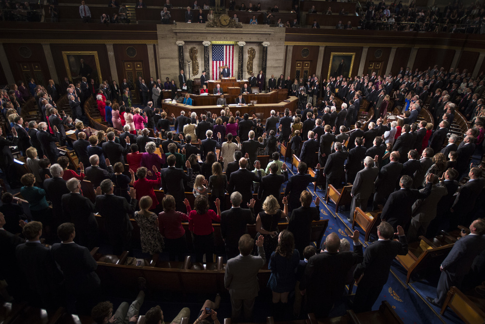 House Speaker John Boehner of Ohio, center front, administers the oath of office to newly elected members of the 114th Congress, as Republicans assume full control for the first time in eight years on Capitol Hill in Washington, DC on Friday January 06, 2015.