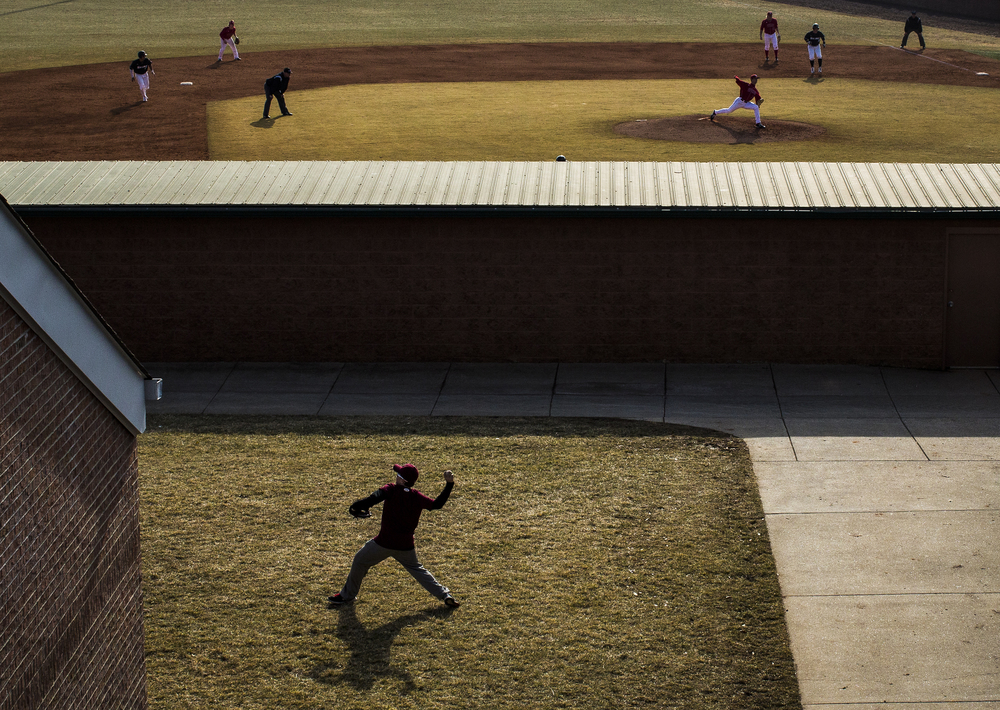 Children play catch as WKU beats Southern Illinois 6-4 on Feb. 16, 2014, at Nick Denes Field in Bowling Green, Ky.