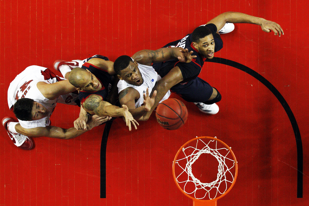 WKU toppers jump for a rebound Saturday February, 4, 2012 against South Alabama at Diddle Arena. WKU won 75-66.