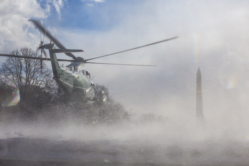 Marine One, with President Barack Obama aboard, takes off in the snow on the south lawn of the White House in Washington, DC on Wednesday January 07, 2015. Obama is traveling to the Detroit area to speak to workers at a Ford automotive plant.