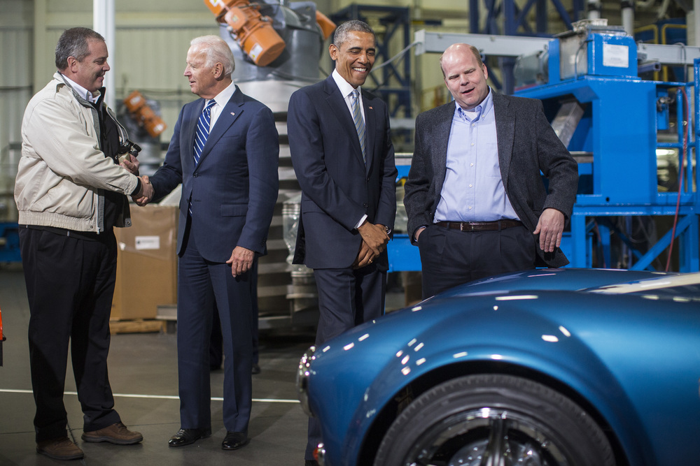 Managing Director of Techmer ES, Tom Drye, left, and Lonnie Love, Shelby Cobra 3D print designer and manufacturer at Oak Ridge National Lab, right, show President Obama and Vice President Joe Biden a 3D printed, carbon fiber replica of a Ford/Shelby Cobra while they visit Techmer PM as Obama announces the latest manufacturing hub which is a series of public private partnerships aimed at boosting advanced manufacturing, fostering American innovation, and attracting well-paying jobs at Techmer PM LLC in Clinton, Tenn. on Friday January 09, 2015.