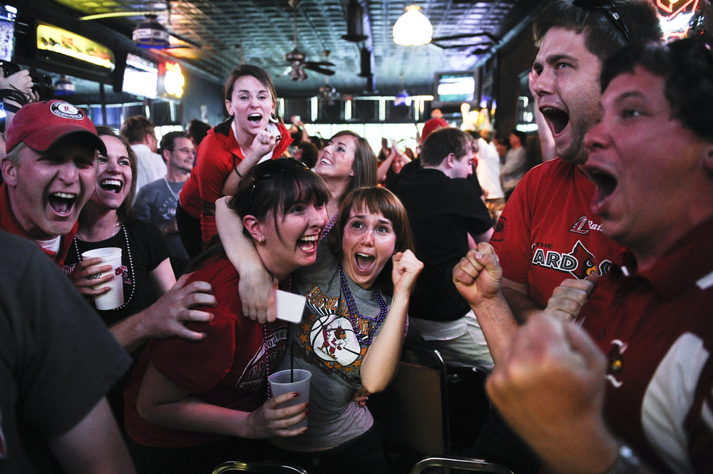Fans of the University of Louisville react to a play at The Granville Inn in Louisville Ky. during the men's NCAA Final Four game against the University of Kentucky. Louisville lost 69-61.
