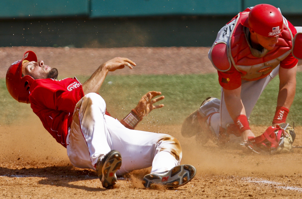 Western Kentucky University senior catcher Matt Rice slides safely into home base during Toppers' game against University of Louisiana Lafayette at Nick Denes Field on Sunday afternoon April 10, 2011. WKU lost 8-6.