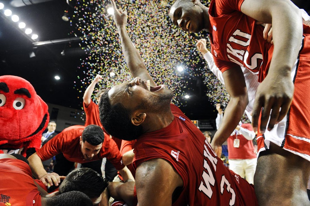 Western Kentucky University senior guard Kahlil McDonald celebrates with his teammates after winning the Sun Belt Conference Tournament in Summit Arena against the University of North Texas on Tuesday, March 6, 2012 in Hot Springs, Ark. McDonald scored 14 points to help WKU win the 2011 Sun Belt Conference Men's Basketball Tournament, 74-70 to advance to the NCAA for the 22nd time and first time since 2009.
