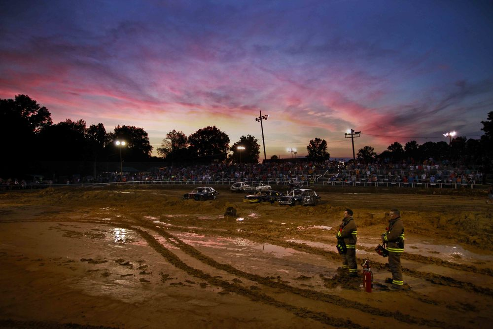 Firemen stand in attention as the national anthem is sung before a demolition derby at the Greensburg Fair in Greensburg Ky. June 14, 2011.