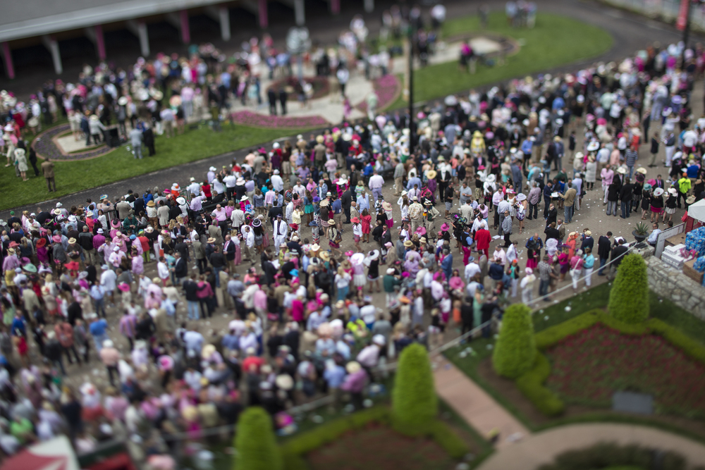 Patrons roam around the paddock are before the 140th Kentucky Oaks at Churchill Downs in Louisville, Ky. on Friday May 02, 2014.