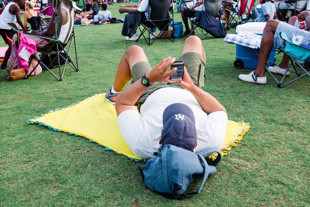 atlanta-jazz-festival-attendee-on-phone