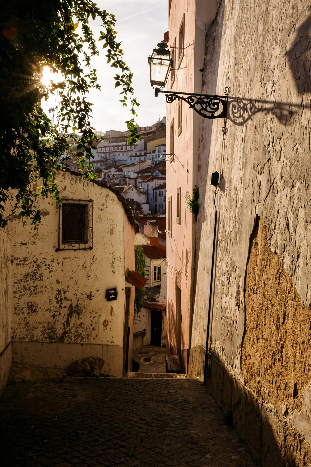 lisbon-portugal-sunset-through-alley
