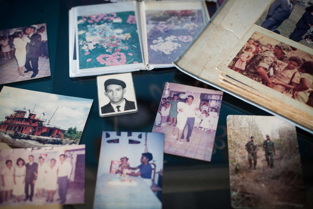 War memories in the family photo album of María Montes, widow of Marines Corp Soldier Hernan Florez. On September 2002, Hernan fell in combat with the FARC guerrilla in rural zone of Ovejas municipality, Colombia. (Cartagena, Colombia, 2016).