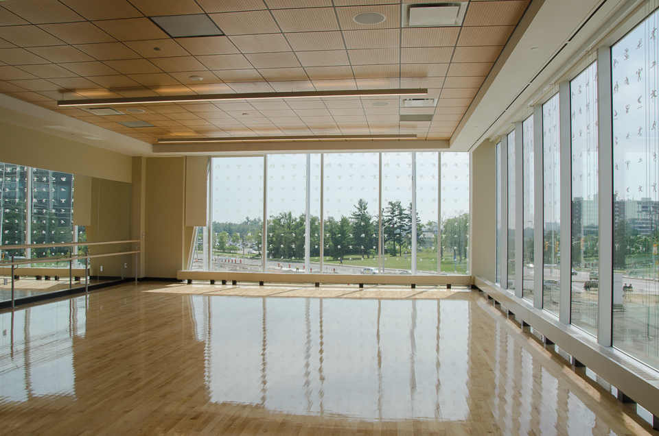 Corner multipurpose studio for community dance classes, combative sports, ballet, and yoga. Photo by Stephanie Calvet.