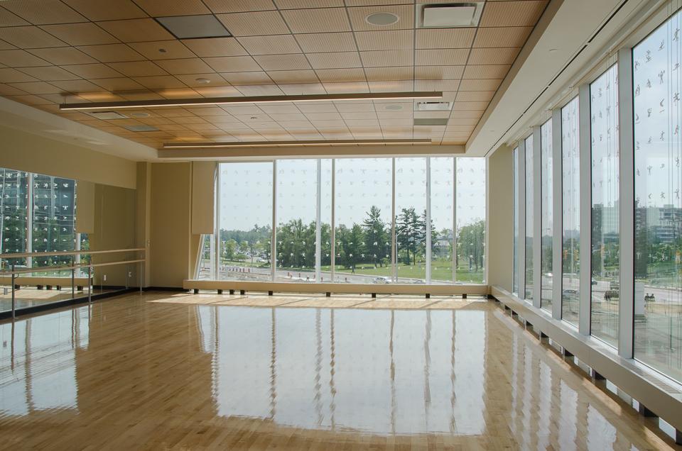 Corner multipurpose studio for community dance classes, combative sports, ballet, and yoga. Photo by Stephanie Calvet.