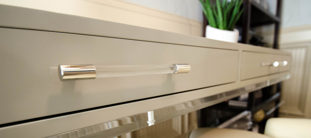 Lucite cabinet hardware on gray desk