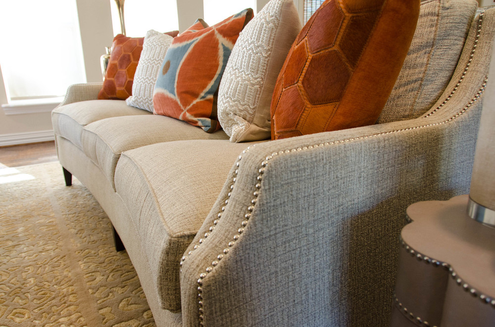 Curved sofa with nail head detail