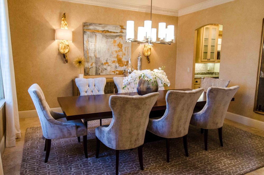 Formal dining room with gray tufted dining chairs