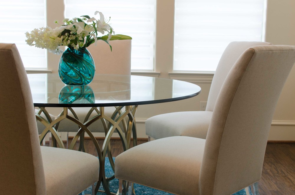 Modern gold base glass top dining table