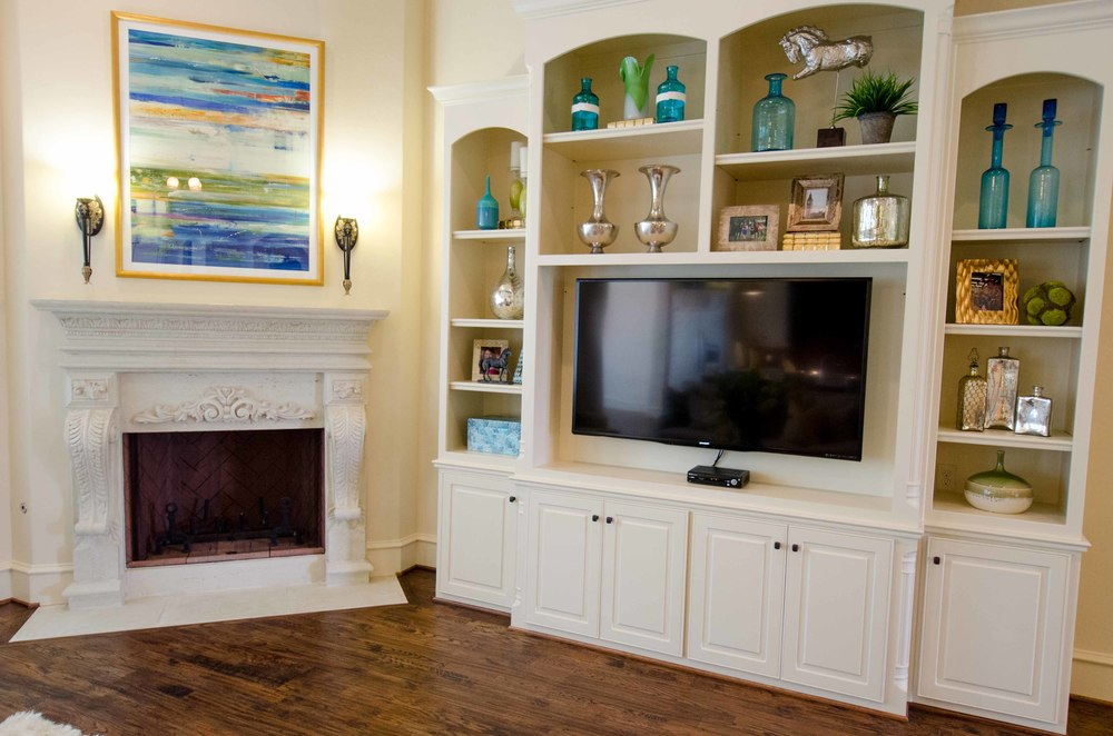 Built in white tv cabinet and corner fireplace