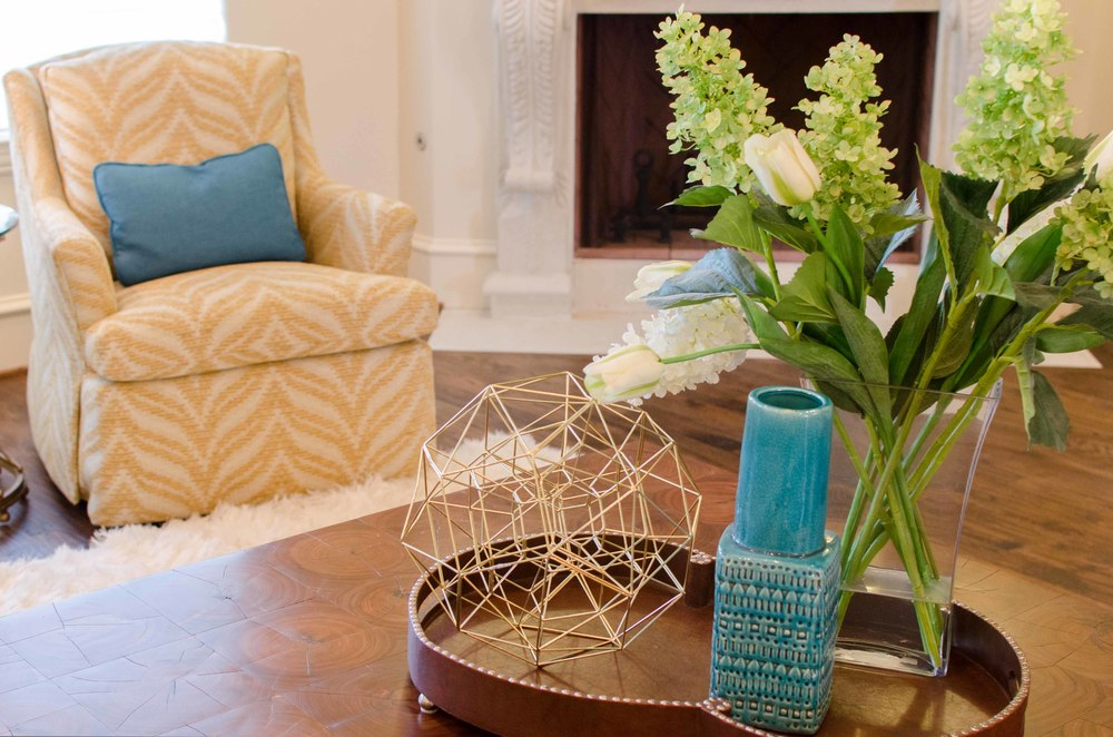 Yellow zebra fabric chair and turquoise accessories