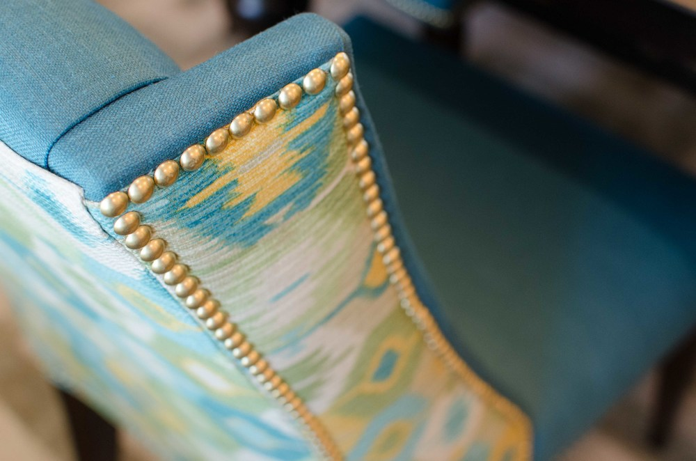 Turquoise wing back chair with gold nail heads