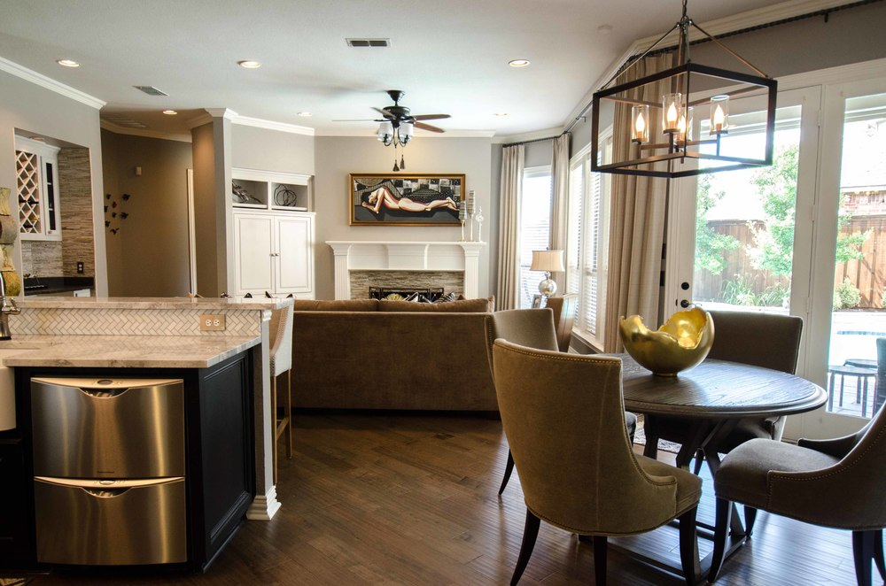 Neutral open concept living, dining, and kitchen