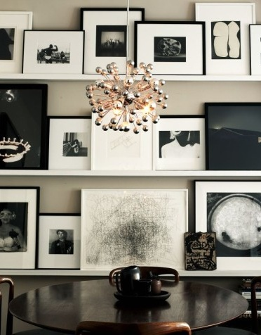 Family photos and art displayed on floating shelves