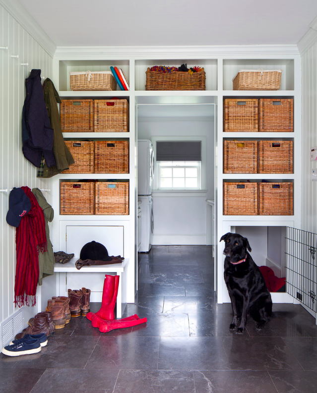 Much like the laundry room, the mudroom is a perfect landing place for the dogs. This idea of a built in dog crate is a super well thought out way of hiding something that is not very pretty.