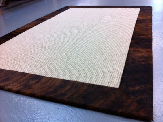 Even more understated hide banded sisal rug because it is tone-on-tone.