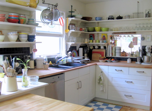 Cluttered open concept kitchen.