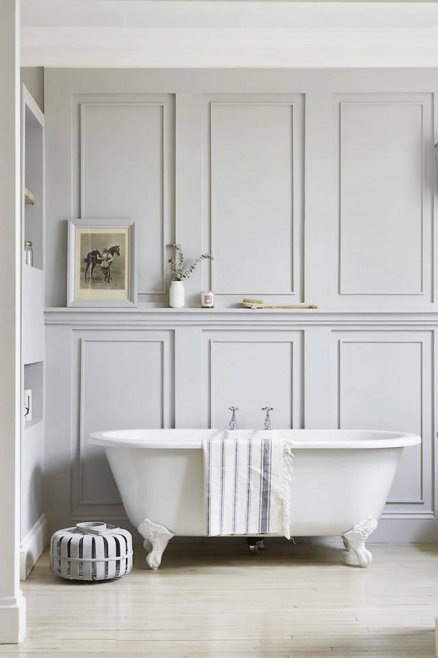 Traditional picture frame molding makes this ball and clawfoot tub feel right at home.