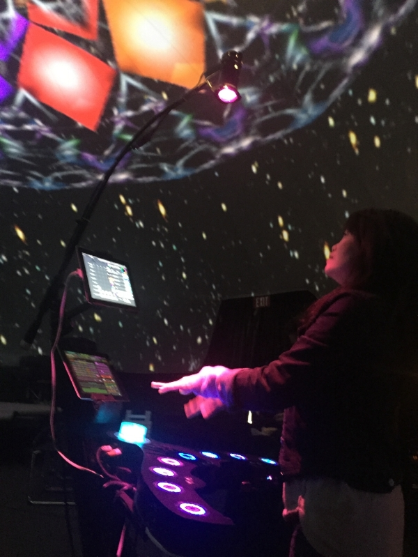 SpaceHarp touchless motion music and visuals controller in Vortex Dome LA.  SpaceHarp player generates live music and seamless fulldome art!