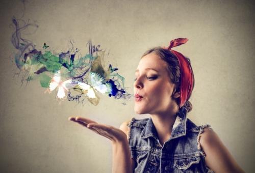 Woman blowing butterflies