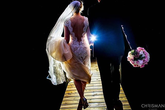 Obsessed with this photo!  Our bride's gown was absolutely gorgeous, and we love how they are walking away into the night.  Thank you Caitlin and Walid for allowing us to be a part of your perfect day!  Photo Cred: @chrismanstudios  #weddingplanner #brideandgroom #veil #nightsky #weddingphotographer #brevardcounty #jordan #melbournefl #merrittisland #destinationwedding #romantic #dreamy #love #disney #weddingdress #bridalbouquet #couplegoals
