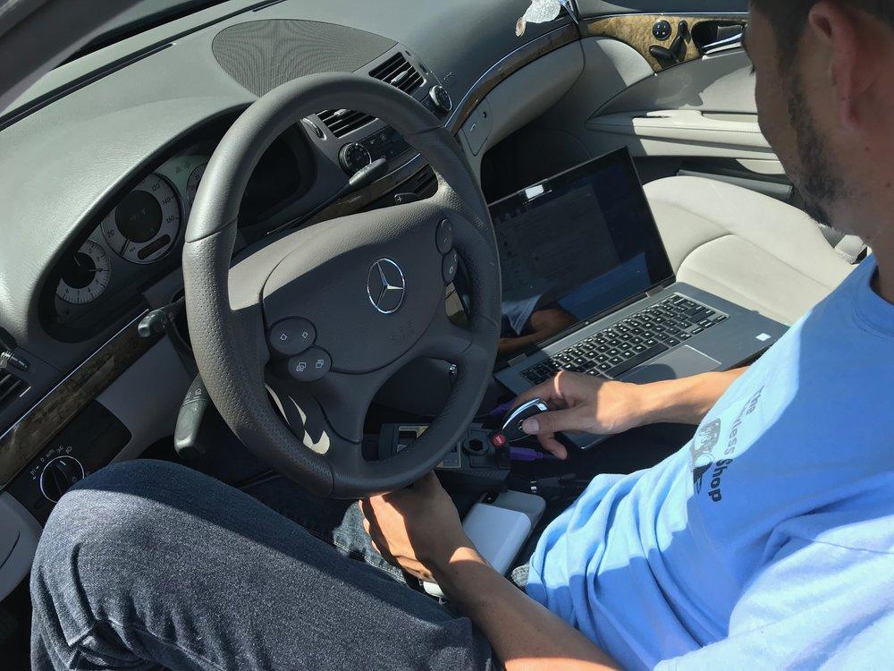 The Keyless Shop programming a Mercedes Key.