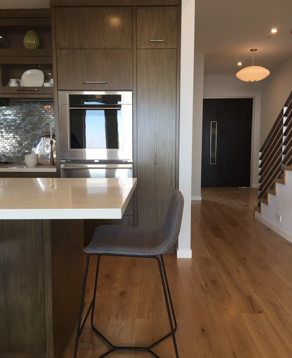 west elm, counter stool, quartz counter, walnut cabinetry, midcentury modern, oak floors, custom kitchen design, stainless steel, wolf appliances, design within reach, y-lighting,