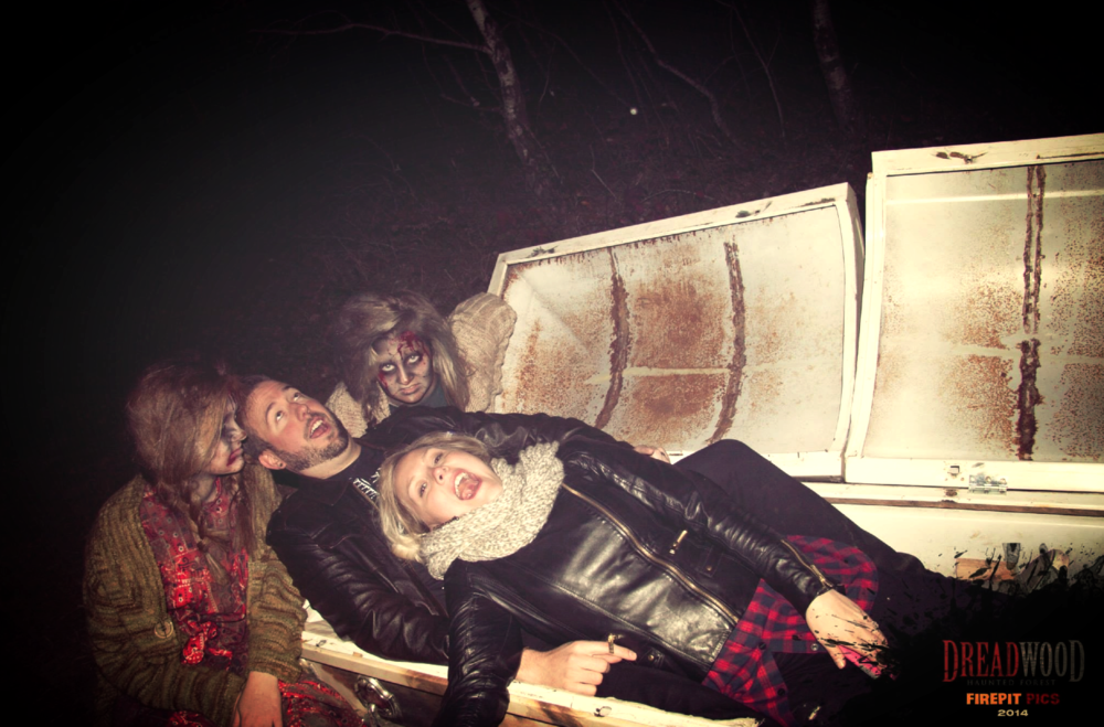 Me screaming inside a coffin with my husband. Two leather jackets, two zombies and one coffin makes perfection.