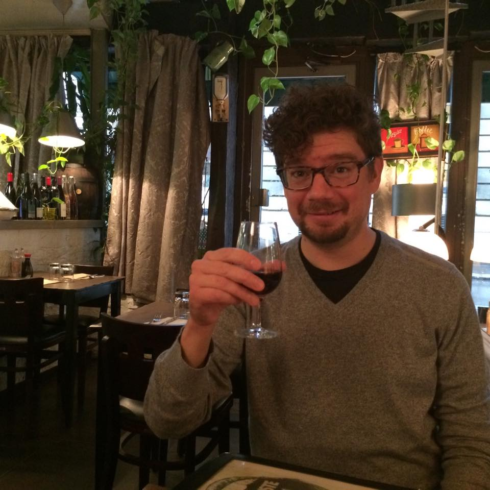 My husband raising a glass at Le Grenier
