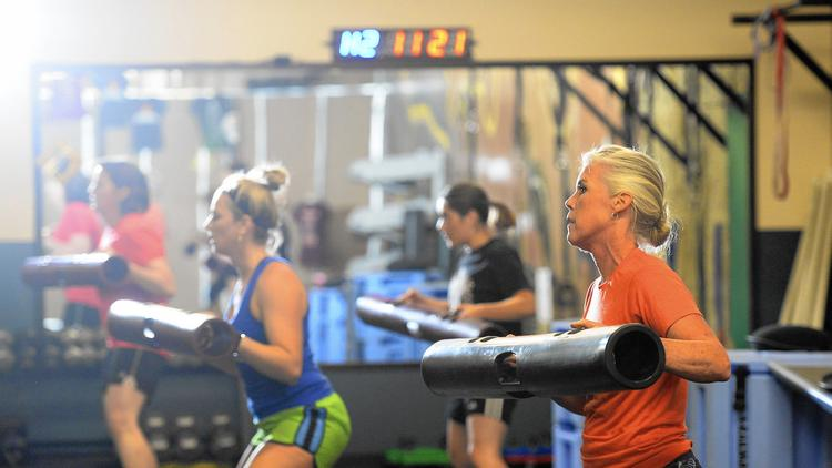 ClassPass, a well-funded start-up, sells unlimited fitness classes at participating studios for about $100 a month, depending on the market. Above, a class in Denver.