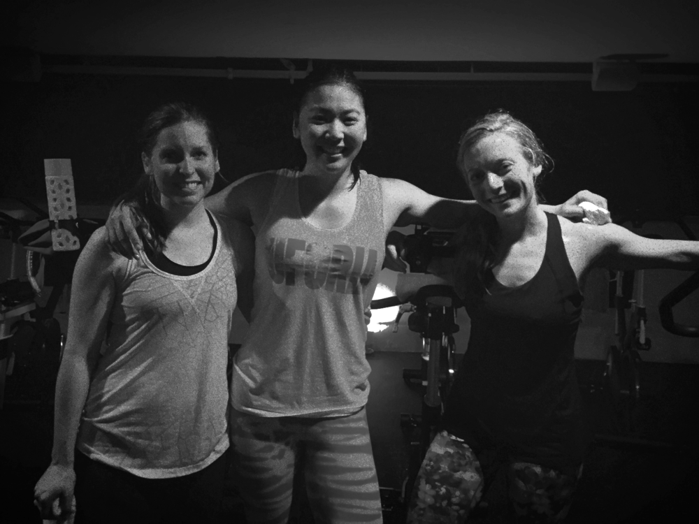 My cousin Maggie, our rockstar instructor Jess, and me drenched after class.